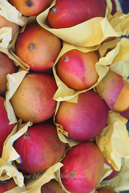 fresh mangoes in paper in market.