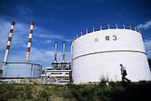 Belgrade, Serbia, Yugoslavia. View of a urban heating plant with chimneys, man.