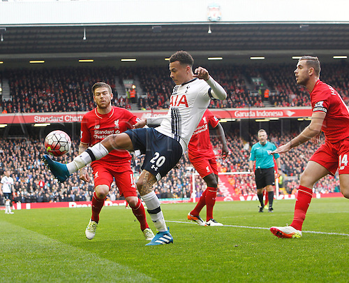 02.04.2016. Anfield, Liverpool, England. Barclays Premier League. Liverpool versus Tottenham Hotspur.  Spurs midfielder Dele Alli controls the ball on the edge of the Liverpool box as Moreno and Henderson close him down.