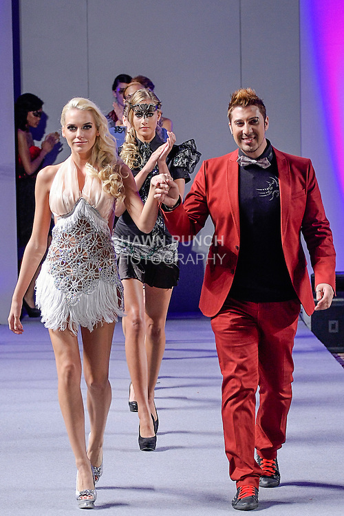 "Fashion designer Giovanni Lo Presti walks runway with models at the close of his Giovani Lo Presti ""Neo-Venezia"" collection fashion show, during Couture Fashion Week in New York City, September 15, 2012."