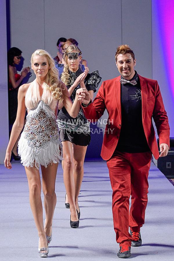 "Fashion designer Giovanni Lo Presti walks runway with models at the close of his Giovani Lo Presti ""Neo-Venezia"" collection fashion show, during Couture Fashion Week in New York City, September 15, 2012."