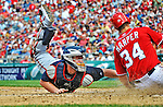 22 July 2012: Atlanta Braves catcher Brian McCann gets Bryce Harper out at the plate during game action against the Washington Nationals at Nationals Park in Washington, DC. The Braves fell to the Nationals 9-2 splitting their 4-game weekend series. Mandatory Credit: Ed Wolfstein Photo