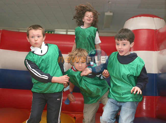 Aaron Duffy, Cian Martin Bohan, Robert Kinch and Alex Kierans have fun on the Bouncing Castle at the Greenhills Summer Camp...Photo NEWSFILE/Jenny Matthews.(Photo credit should read Jenny Matthews/NEWSFILE)....This Picture has been sent you under the condtions enclosed by:.Newsfile Ltd..The Studio,.Millmount Abbey,.Drogheda,.Co Meath..Ireland..Tel: +353(0)41-9871240.Fax: +353(0)41-9871260.GSM: +353(0)86-2500958.email: pictures@newsfile.ie.www.newsfile.ie.FTP: 193.120.102.198.