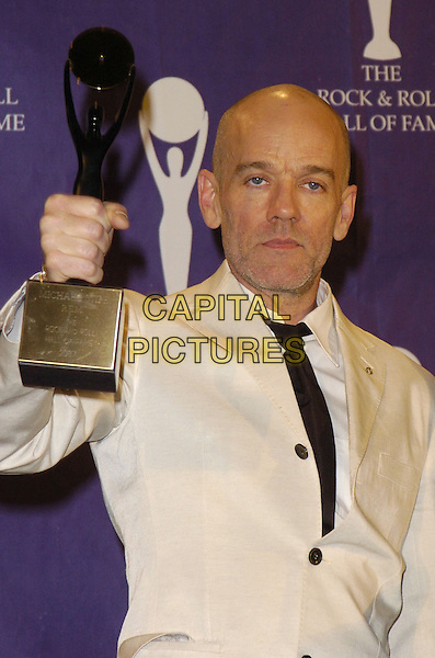 MICHAEL STIPE - R.E.M..The 22nd annual Rock And Roll Hall Of Fame  induction ceremony at the Waldorf Astoria Hotel, New York, New York, USA..March 12th, 2007.half length rem white suit jacket award trophy .CAP/ADM/BL.©Bill Lyons/AdMedia/Capital Pictures *** Local Caption ***