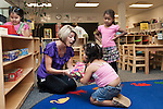 September 14, 2011. Raleigh, NC. . After nap time, Kim Jackson, the head teacher for the class, helps her students fold up their blankets.. Project Enlightenment, a public pre-kindergarten program for at risk children, has been threatened with closure due to state wide budget cuts..