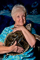 Jean Beasley runs the Karen Beasley Rehabilitation Center and at any given time of the year might be caring for over 20 turtles that are sick and/or injured. Her efforts in sea turtle conservation earned her the 2007 Animal Planet Hero of the Year Award. Pictured here with a Kemp Ridley Sea Turtle. Lepidochelys kempii. Karen Beasley Rehabilitation Center, Topsail Island, North Carolina, USA.