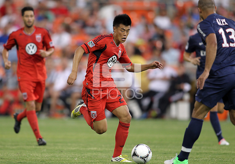 WASHINGTON, DC - July 28, 2012:  Long Tan (27) of DC United moves up on Alex (13) of PSG (Paris Saint-Germain) in an international friendly match at RFK Stadium in Washington DC on July 28. The game ended in a 1-1 tie.