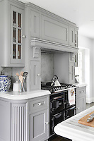 An electric range in the kitchen demonstrates that this period home is also a practical one, designed around modern family life