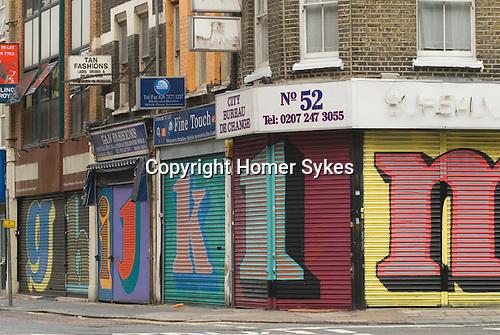 Middlesex Street East End London E1. Alphabet Street project on shop shutters work by street artist Ben Eine (real name Ben Flynn).