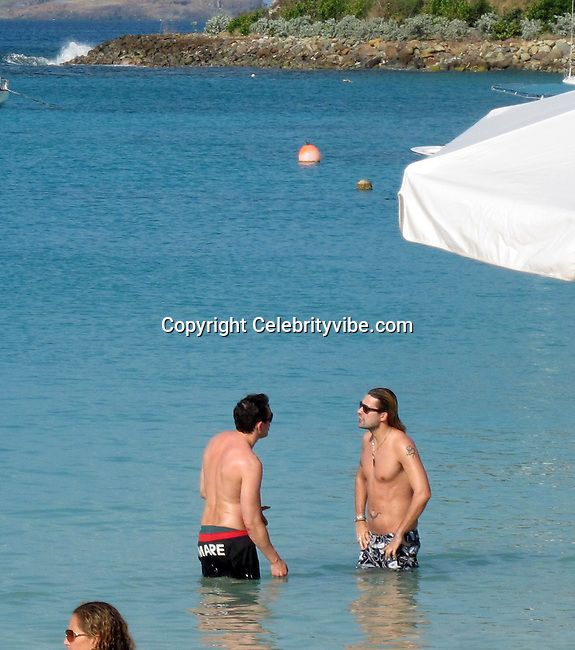 **EXCLUSIVE**David Garrett.Violinist David Garrett relaxing on the beach with friends after celebrating the New Year.St. Barth, Caribbean.Friday, January 07, 2011.Photo By CelebrityVibe.com.To license this image please call (212) 410 5354; or Email: CelebrityVibe@gmail.com ; website: www.CelebrityVibe.com