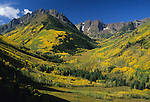 Pyramid Peak, left, and the Maroon Bells, right, near Aspen, Colorado, at the peak of fall. © Michael Brands.