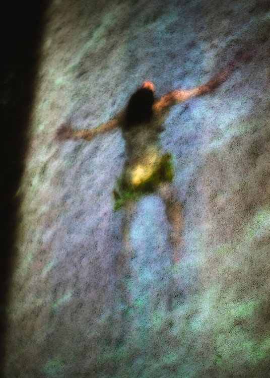 A blurry abstract photo of a person swimming