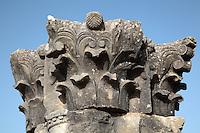 Roman Corinthian stone capital atop a column at the colonnade of the Capitoline Temple, 218 AD, in Volubilis, Northern Morocco. Volubilis was founded in the 3rd century BC by the Phoenicians and was a Roman settlement from the 1st century AD. Volubilis was a thriving Roman olive growing town until 280 AD and was settled until the 11th century. The buildings were largely destroyed by an earthquake in the 18th century and have since been excavated and partly restored. Volubilis was listed as a UNESCO World Heritage Site in 1997. Picture by Manuel Cohen