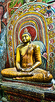 Seated Buddha with pretty colorful backdrop. (Photo by Matt Considine - Images of Asia Collection)