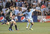 Roger Espinoza (15) Sporting KC in action..Sporting Kansas City defeated Seattle Sounders on penalty kicks, after a 1-1 tied game to win the Lamar Hunt Open Cup at LIVESTRONG Sporting Park, Kansas City, Kansas..