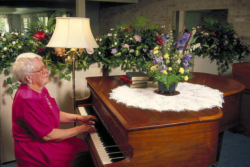 Older lady playing piano