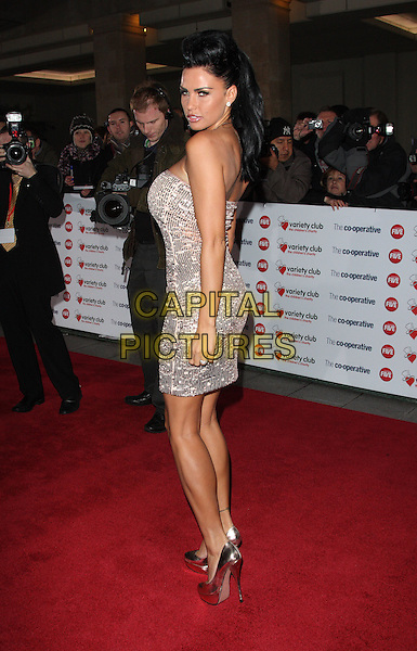 KATIE PRICE (JORDAN).The Co-operative Variety Club Showbiz Awards, Grosvenor House Hotel, Park Lane, London, England, UK, 14th November 2010. .full length strapless silver sequined sequin dress shoes platform shiny fake tanned tan back over shoulder rear behind side.CAP/ROS.©Steve Ross/Capital Pictures