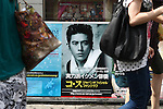 July 23, 2010 - Tokyo, Japan - People walk past a commercial poster featuring the South Korean actor Ko Soo, near JR Shin-okubo station in Tokyo, Japan, on July 23, 2010. Japanese fans of South Korean actor and singer Park Yong-ha, who commits suicide on June 30th, visited a memorial altar set up at a Korean restaurant in Tokyo's Okubo district, where many Koreans live.