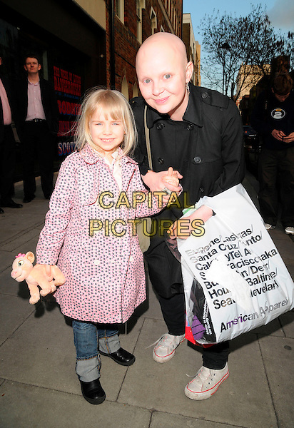 HONEY HIPGRAVE & GAIL PORTER.The London Restaurant Week launch party, The Hospital bar & club, London, England..March 31st, 2008.full length black coat pink polka dot holding hands stuffed toy doll plastic bag mother mom mum daughter family crouching .CAP/CAN.©Can Nguyen/Capital Pictures.