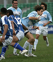 Juan Pablo Socimo of Argentina breaks the Samoan defence.