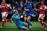Seattle, WA - Thursday, May 26, 2016: Arsenal Ladies FC goalkeeper Emma Byrne (1) makes a stop on Seattle Reign FC defender Paige Nielsen (12). The Seattle Reign FC of the National Women's Soccer League (NWSL) and Arsenal Ladies FC of the Women's Super League (FA WSL) played to a 1-1 tie during an international friendly at Memorial Stadium.
