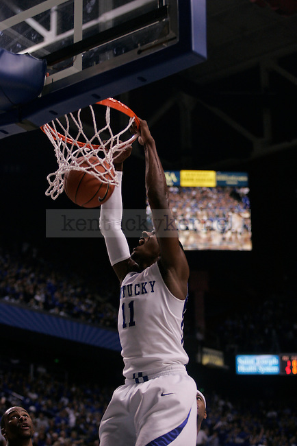 UK freshman guard John Wall dunks during the first half of the men's basketball game against Clarion at Rupp Arena on Friday, Nov. 6, 2009. The Wildcats won 117-52 over the Golden Eagles. Photo by Adam Wolffbrandt | Staff