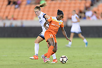 Houston, TX - Saturday July 08, 2017: Emily Sonnett and Nichelle Prince battle for control of the ball during a regular season National Women's Soccer League (NWSL) match between the Houston Dash and the Portland Thorns FC at BBVA Compass Stadium.