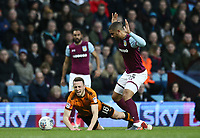 Diogo Jota of Wolverhampton Wanderers challenged by Lewis Grabban of Aston Villa <br /> <br /> Photographer Leila Coker/CameraSport<br /> <br /> The EFL Sky Bet Championship - Aston Villa v Wolverhampton Wanderers - Saturday 10th March 2018 - Villa Park - Birmingham<br /> <br /> World Copyright &copy; 2018 CameraSport. All rights reserved. 43 Linden Ave. Countesthorpe. Leicester. England. LE8 5PG - Tel: +44 (0) 116 277 4147 - admin@camerasport.com - www.camerasport.com