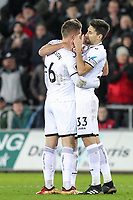 Federico Fernandez of Swansea City congratulates goalscorer Alfie Mawson of Swansea City during the Premier League match between Swansea City and Liverpool at the Liberty Stadium, Swansea, Wales on 22 January 2018. Photo by Mark Hawkins / PRiME Media Images.