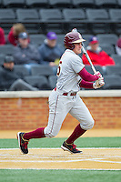 Brett Knief (25) of the Florida State Seminoles follows through on his swing against the Wake Forest Demon Deacons at Wake Forest Baseball Park on April 19, 2014 in Winston-Salem, North Carolina.  The Seminoles defeated the Demon Deacons 4-3 in 13 innings.  (Brian Westerholt/Four Seam Images)