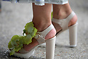 Street Style during Paris Fashion Week Spring Summer 2018 on Saturday 30th September 2017. Image shows a pair of high heel sandals embellished with orchids  (Photo by JSTREETSTYLE/AFLO)