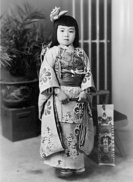 seven years old girl made up for her Shichi Go San celabration Japan 1950s