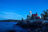 A view of the historic Eagle Harbor Lighthouse taken at dusk along the Lake Superior shoreline. Eagle Harbor, MI