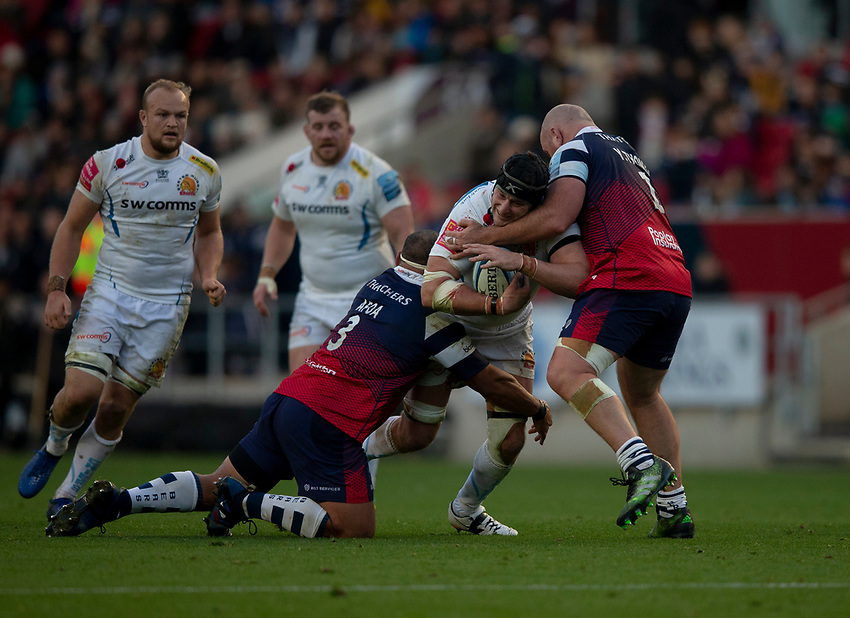 Exeter Chiefs' Mitch Lees is tackled by Bristol Bears' Yann Thomas and Bristol Bears' John Afoa<br /> <br /> Photographer Bob Bradford/CameraSport<br /> <br /> Gallagher Premiership Round 7 - Bristol Bears v Exeter Chiefs - Sunday 18th November 2018 - Ashton Gate - Bristol<br /> <br /> World Copyright © 2018 CameraSport. All rights reserved. 43 Linden Ave. Countesthorpe. Leicester. England. LE8 5PG - Tel: +44 (0) 116 277 4147 - admin@camerasport.com - www.camerasport.com