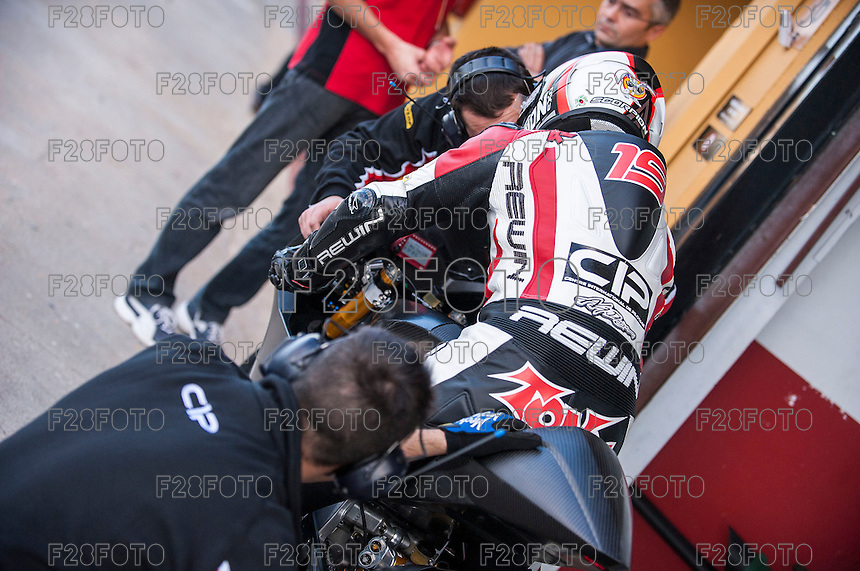 Pilos and his mechanics in pit line at pre season winter test IRTA Moto3 & Moto2 at Ricardo Tormo circuit in Valencia (Spain), 11-12-13 February 2014