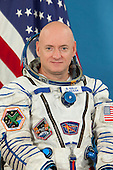 This file photo of NASA astronaut Scott Kelly, attired in a Russian Sokol launch and entry suit, was taken in Star City, Russia in August, 2010 prior to his earlier missions aboard the ISS. Kelly, and Mikhail Kornienko, have been selected by NASA, the Russian Federal Space Agency (Roscosmos), and their international partners for a one-year mission aboard the International Space Station in 2015. This mission will include collecting scientific data important  to future human exploration of our solar system.  Kelly, a captain in the United States Navy, is from Orange, New Jersey. He has degrees from the State University of New York Maritime College and the University of Tennessee, Knoxville. He served as a pilot on space shuttle mission STS-103 in 1999, commander on STS-118 in 2007, flight engineer on the International Space Station Expedition 25 in 2010 and commander of Expedition 26 in 2011. Kelly has logged more than 180 days in space. Scott's twin brother Mark is a retired NASA astronaut and is married to former U.S. Representative Gabrielle Giffords (Democrat of Arizona)..Credit: Roscosmos/Gagarin Cosmonaut Training Center via CNP