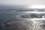 Coastal landscape of salt marsh and drainage channels along the coastline off Faro, Algarve, Portugal