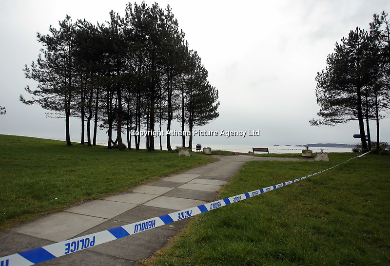 Pictured: Police at the scene where a body was discovered in Swansea Bay, near the Civic Centre, Wales, UK. Wednesday 08 March 2017<br /> Re: A body has been discovered on Swansea foreshore.<br /> The body was found at first light, close to the city's Civic Centre and Marriott Hotel.<br /> Police officers are on site beginning their investigation on the beach. They have yet to reveal if the individual is a male or a female.<br /> Part of the pavement above the beach is cordoned off.<br /> No-one has been reported by police as missing in the Swansea area recently, as far as the Evening Post is aware.