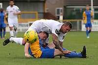 Kenny Pogue of Hastings tumbles over Danny Cossington of Romford during Romford vs Hastings United, FA Trophy Football at Ship Lane on 8th October 2017