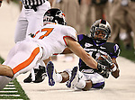 TCU Horned Frogs wide receiver Skye Dawson #11 gets knocked out of bounds by Oregon State Beavers cornerback Brandon Hardin #17 after catching a pass during the game between the Oregon State Beavers and the TCU Horned Frogs at the Cowboy Stadium in Arlington,Texas. TCU defeated Oregon State 30-21.