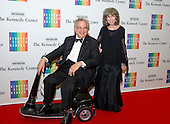 Itzhak Perlman and his wife, Toby, arrive for the formal Artist's Dinner honoring the recipients of the 2014 Kennedy Center Honors hosted by United States Secretary of State John F. Kerry at the U.S. Department of State in Washington, D.C. on Saturday, December 6, 2014. The 2014 honorees are: singer Al Green, actor and filmmaker Tom Hanks, ballerina Patricia McBride, singer-songwriter Sting, and comedienne Lily Tomlin.<br /> Credit: Ron Sachs / Pool via CNP