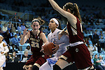 01 February 2015: North Carolina's Jessica Washington (center) is defended by Boston College's Kelly Hughes (23) and Alexa Coulombe (right). The University of North Carolina Tar Heels hosted the Boston College Eagles at Carmichael Arena in Chapel Hill, North Carolina in a 2014-15 NCAA Division I Women's Basketball game. UNC won the game 72-60.