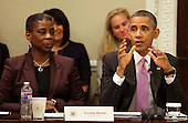 United States President Barack Obama delivers remarks at a meeting of his Export Council in the Eisenhower Executive Office Building in Washington, DC on September 19, 2013.  At left is Ursula M. Burns, Chairwoman and CEO of Xerox.<br /> Credit: Yuri Gripas / Pool via CNP