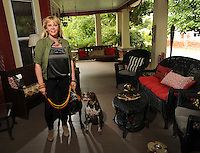 NWA Democrat-Gazette/ANDY SHUPE<br /> Amy White's favorite place is the front porch at her historic Fayetteville home which she shares with her dogs Harper (left) and Natalie. Tuesday, Aug. 18, 2015