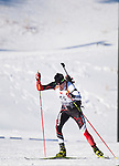Canadian biathlon athlete Nathan Smith skies off the range after shooting his standing targets at The International Biathlon Union Cup # 7 Men's 10 KM Sprint held at the Canmore Nordic Center in Canmore Alberta, Canada, on Feb 16, 2012.  Nathan goes on to win this race, his third win of three sprints held in Canmore.  Two sprints were held the previous weekend in Cup 6. Photo by Gus Curtis.