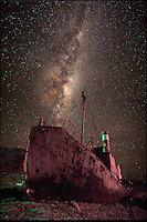 BNPS.co.uk (01202 558833).Pic: SamanthaCrimmin/BNPS..***Please Use Full Byline***..The Milky Way above the Petrel in South Georgia...A British Doctors braved freezing conditions to capture unique pictures of the night sky from the tiny British island of South Georgia in the remote South Atlantic...Amateur photographer Samantha Crimmin's stunning photos of the sky at night over South Georgia have left locals so star-struck they have been turned into stamps...Dr Samantha Crimmin was working as an emergency medic for the British Antartic Survey team when she took the celestial images in her spare time...Dr Crimmin used long exposures and plenty of patience to create the incredible shots that show star trails in a perfect circular motion...Her gallery of photos depict the night sky above different locations on the tiny outpost in the south Atlantic...They include one above the Harker Glacier - named after British geologist Alfred Harker - and over the wrecks of two Norwegian whaling ships at Grytviken.