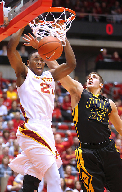 Iowa State's  Craig Brackins (21) dunks over Iowa's Eric May (25) at Hilton Coliseum in Ames, Iowa, December 11, 2009.