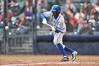 Hartford Yard Goats right fielder Raimel Tapia (15) attempts to lay down a bunt during a game against the Richmond Flying Squirrels at The Diamond on April 30, 2016 in Richmond, Virginia. The Yard Goats defeated the Flying Squirrels 5-1. (Tony Farlow/Four Seam Images)