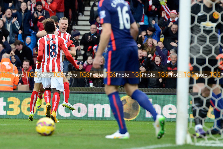 Ryan Shawcross (facing) of Stoke City celebrates his goal with teammates - Stoke City vs Manchester United - Barclays Premier League Football at the Britannia Stadium, Stoke-on-Trent - 01/01/15 - MANDATORY CREDIT: Greig Bertram/TGSPHOTO - Self billing applies where appropriate - contact@tgsphoto.co.uk - NO UNPAID USE