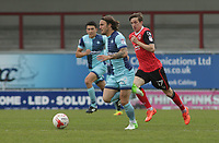 Sam Saunders of Wycombe Wanderers is chased down by Andrew Fleming (R) of Morecambe during the Sky Bet League 2 match between Morecambe and Wycombe Wanderers at the Globe Arena, Morecambe, England on 29 April 2017. Photo by Stephen Gaunt / PRiME Media Images.